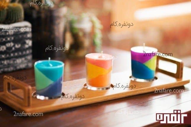 شمع رنگی زیبا در لیوان