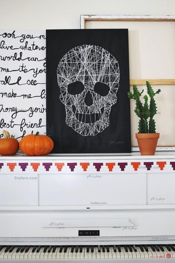 تابلو گرافیکی ساخته شده از میخ و نخ و کنجی با تم هالووین