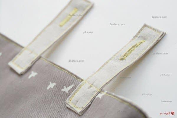 دوخته شدن بندهای کیف به پشت بدنه ی اصلی کیف