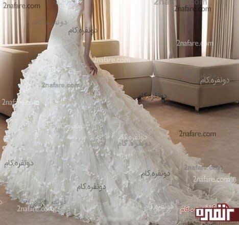 لباس عروس مدل سرور بالاتنه ی برش ماهی و دامن طبقه ای و پفدار