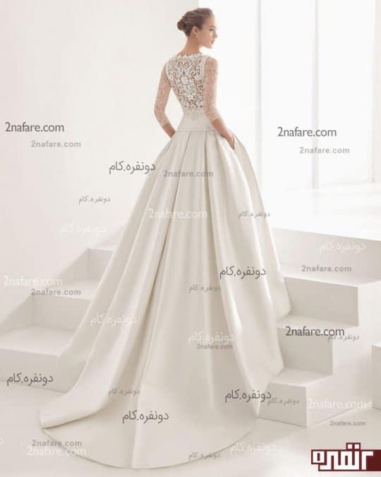 لباس عروس با دامن پفی ساده و دنباله دار