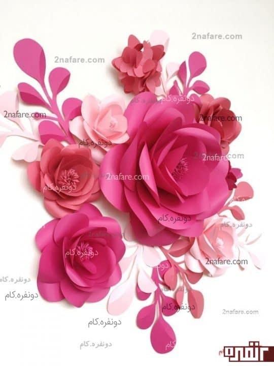 تزیین دیوارها با گل های مقوایی رنگارنگ