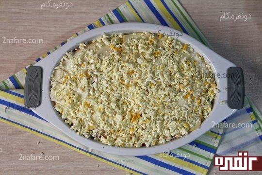 ریختن پنیر برای لایه آخر