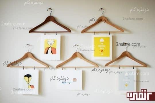 تابلوهای مورد علاقه ی خود را روی دیوار نصب کنید