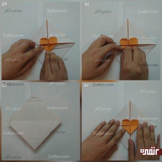مثلث دیگر را به پشت تا کنید تا شکل قلب درست شود