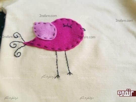 گنجشک نمدی روی لباس کودک