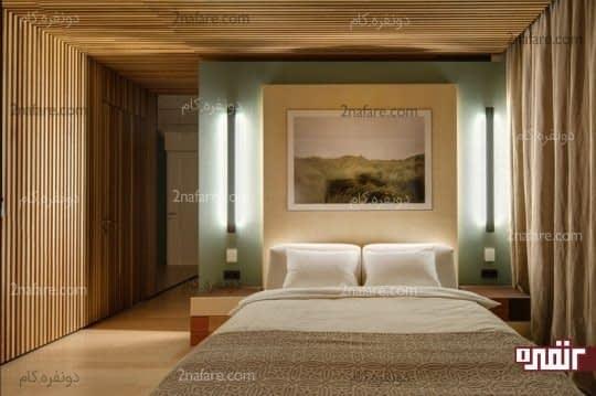 دیزاین دیوار بالای تخت با تابلوی هنری