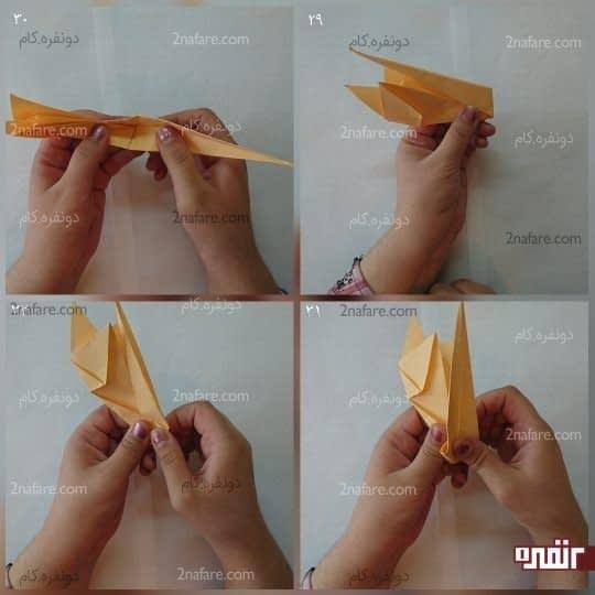 راس مثلث بزرگ را مانند شکل به سمت چپ ببرید تا کنید