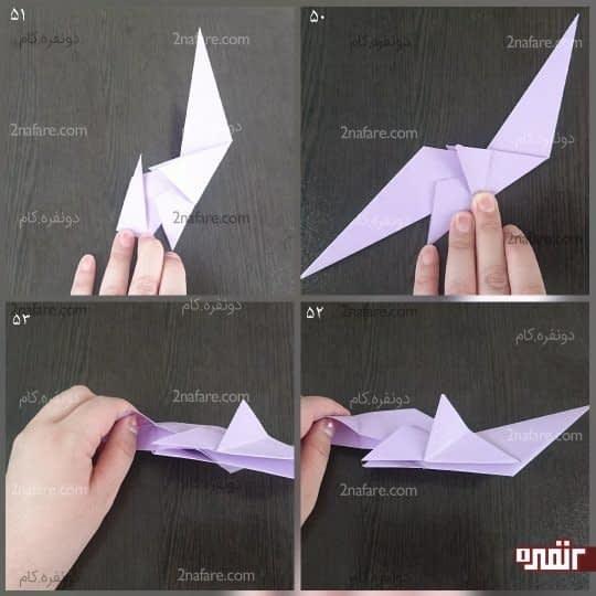 سر مثلث سمت چپ را گرفته و آن را مانند شکل به سمت بالا تا کنید