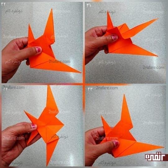 برای باله های ماهی، آن دو مثلث بزرگی که از هم کمی جدا هستند را مانند شکل، از داخل به سمت چپ تا کنید