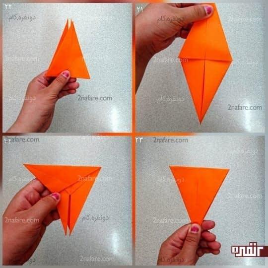 مثلث بزرگ دیگر را به پشت کار، به بالا تا کنید تا یک مثلث داشته باشید