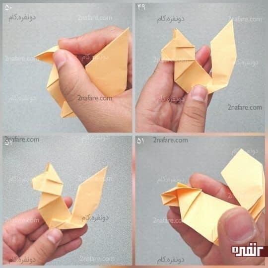 سر مثلثی که به سمت چپ قرار گرفته را کمی به سمت راست ببرید، تا یک مثلث کوچک تشکیل شود