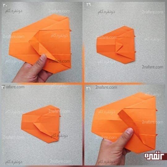قسمت سمت راست کار را روی سمت چپ کار ببرید تا جایی که سر دو مثلث کوچکی که الان در پشت کار قرار دارد را ببینید