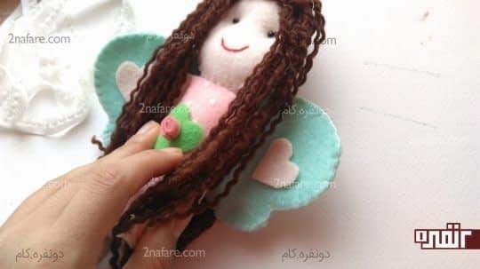 چسباندن عروسک