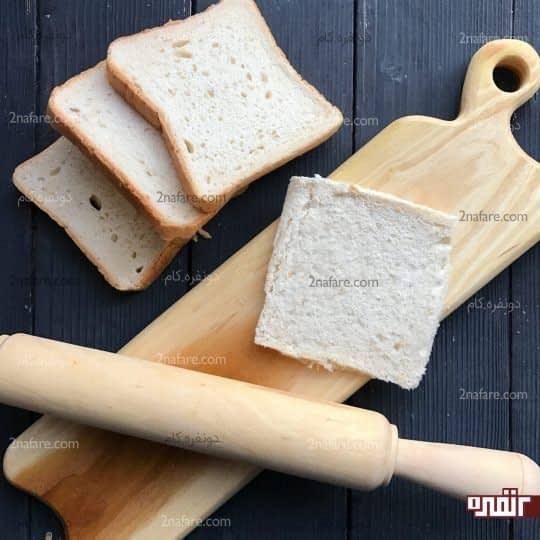 فشرده کردن نان با وردنه