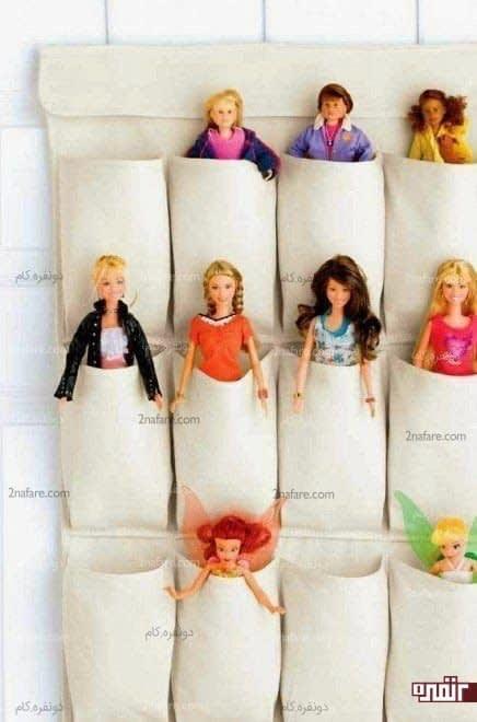 آویز پارچه ای برای مرتب کردن عروسک ها در اتاق دختران