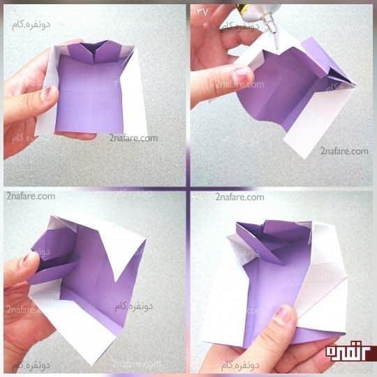 دو طرف و پایین کار دو مربع درست شده است که باید مانند شکل قطر آن را تا کنید