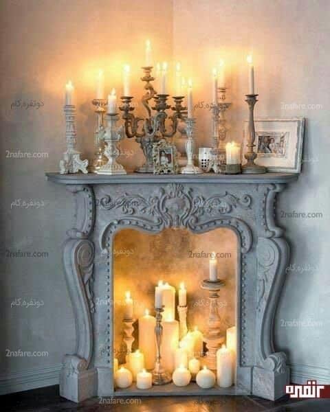 شومینه ی فرانسوی احاطه شده با شمع ها