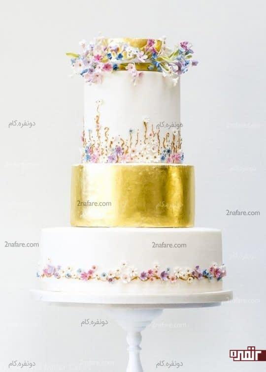 تزیین کیک عروسی با روکش و شکوفه های فوندانت