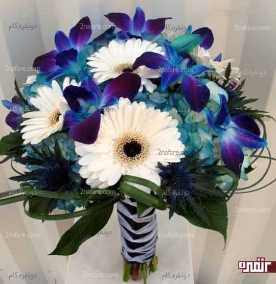 دسته گل عروس با ارکیده آبی و ژربرای سفید