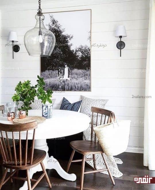 فضای دنج و زیبای غذاخوری با میز گرد سفید