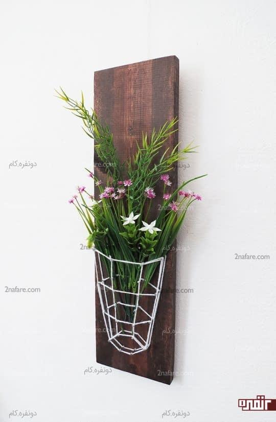 مشخص کردن طرح گلدان به صورت سه بعدی روی تابلو با استفاده از کاموا