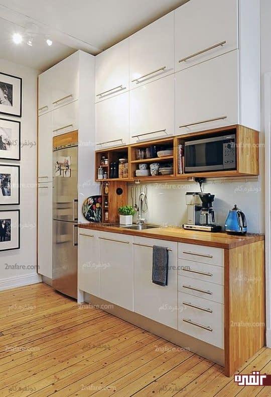 کابینت و قفسه های متعدد برای مرتب و بزرگ نشان دادن آشپزخانه