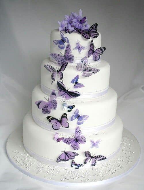 مدل کیک عروسی با تزیین پروانه های بنفش