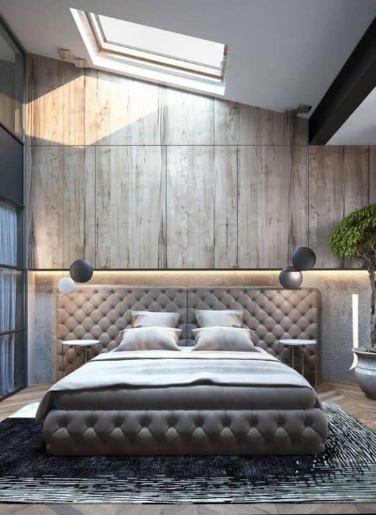 پنجره ی سقفی و چراغ آویزها برای بزرگتر نشان دادن اتاق خوابی کوچک