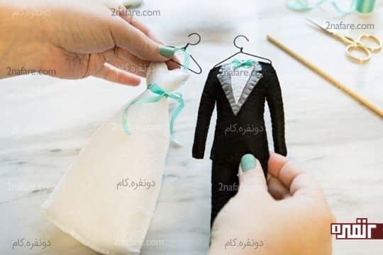 آماده شده ی لباس عروس و داماد نمدی