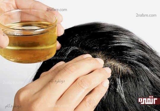 ماساژ مو با روغن گرم، ریزش مو را کنترل میکنه