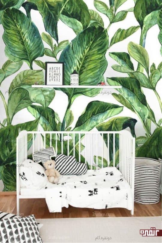 اتاق خواب کودکانه با طراحی خنثی و طرح برگ های موز برای دیوار