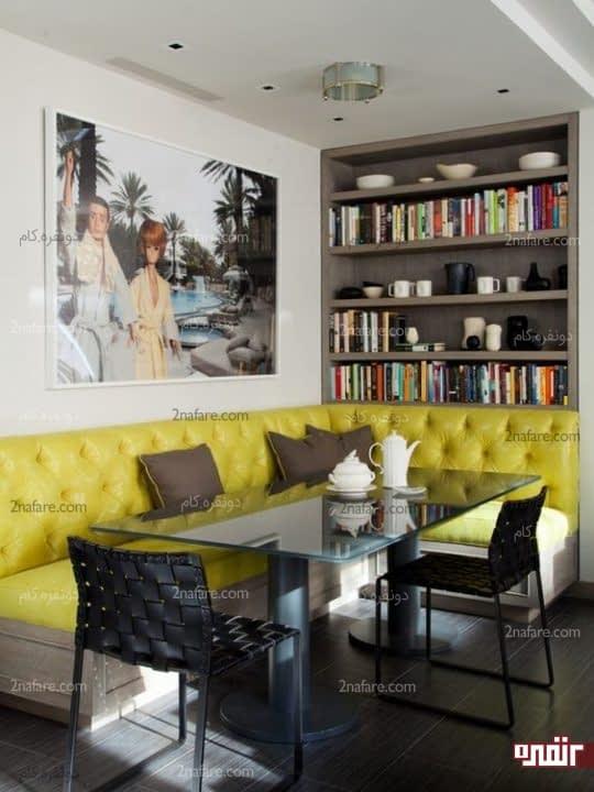 تزیین دیوار غذاخوری با تابلو و قفسه کتاب