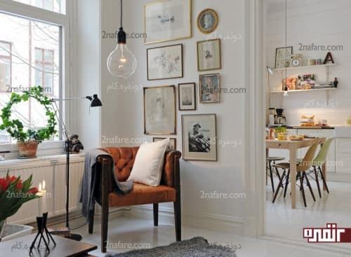گالری دیواری زیبا و یک صندلی راحت برای استراحت