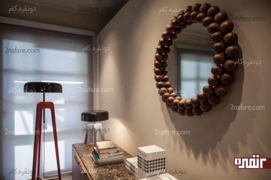 آینه ای خاص و زیبا با قاب چوبی برای تزیین فضا