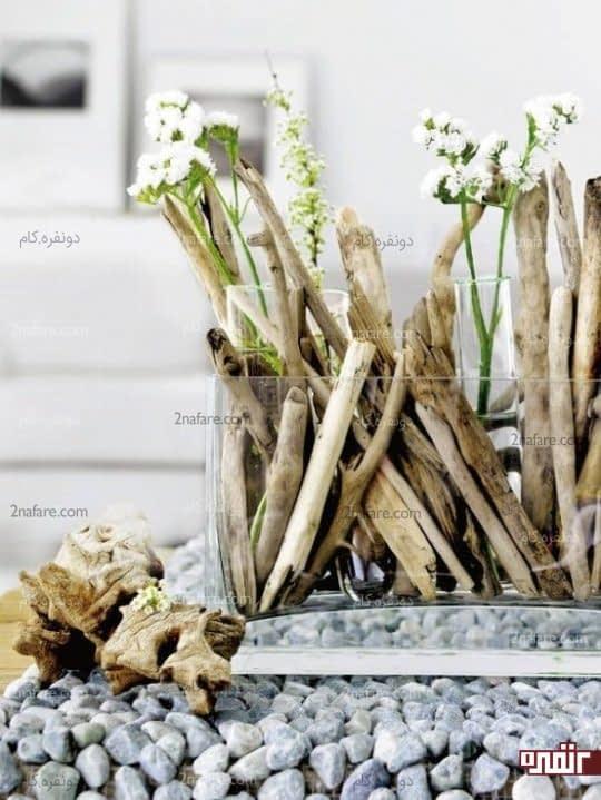 باکس زیبای گل با تزیین چوب های ساحلی