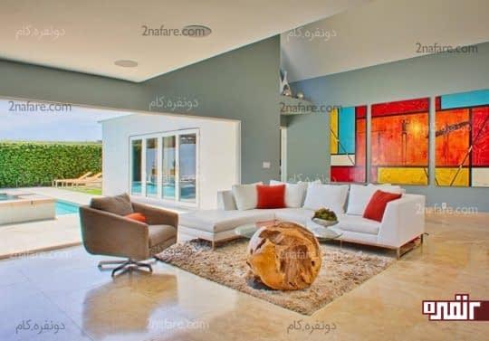 تزیین دیوار اتاق نشیمن با تابلوی چند قطعه ای و رنگارنگتزیین دیوار اتاق نشیمن با تابلوی چند قطعه ای و رنگارنگ