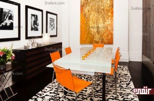 اتاق غذاخوری با تابلو و صندلی های نارنجی رن