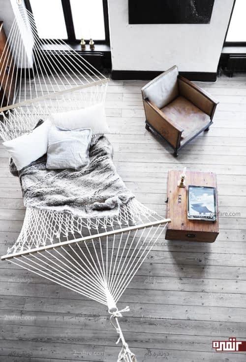 فضایی راحت برای خواب در اتاق نشیمن با صندلی بزرگ گهواره ای