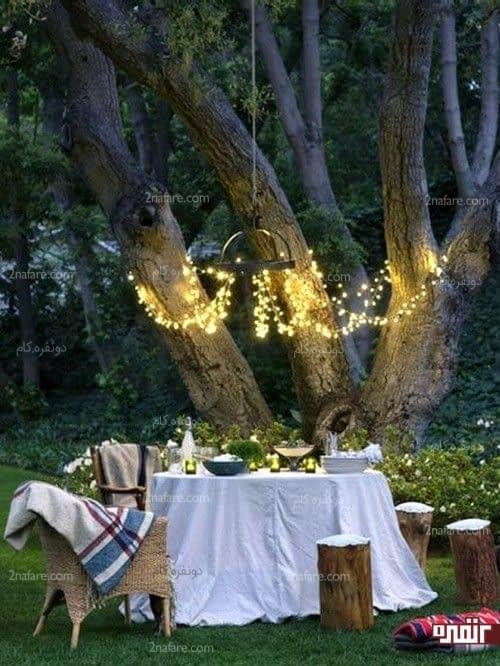 نورپردازی میزغذاخوری با شمع و لامپهای رشته ای