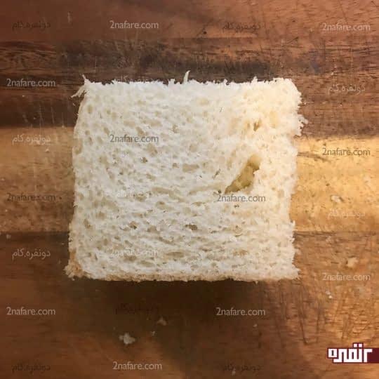 قرار دادن نان تست دوم روی الویه