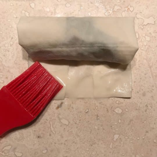 پیچیدن خمیر